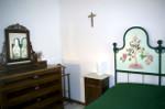 Interior - green double bedroom